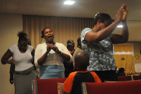 Pastor Lascase's congregation feels the spirit. (Photo by Ryan Blackwell - Public Opinion)
