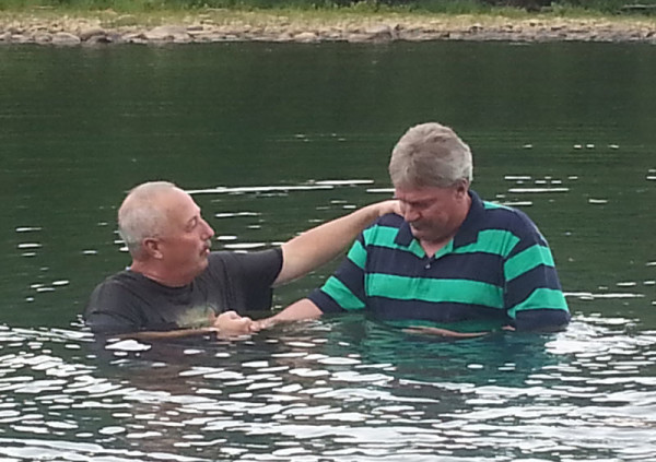 Pastor Marshall Woods (left) conducting a baptism.