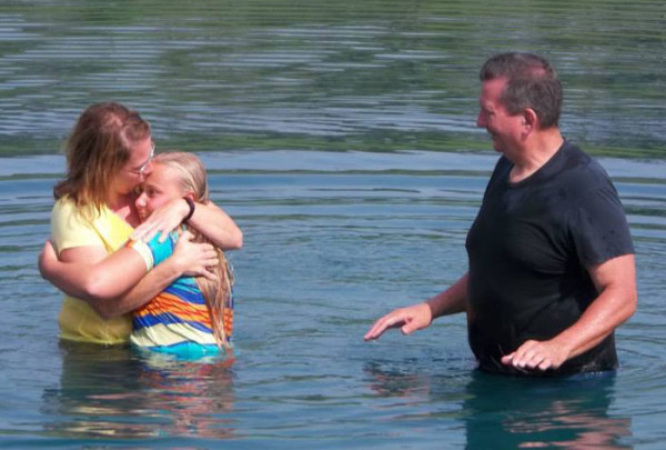 Pastor Wagner completes one of the baptisms.