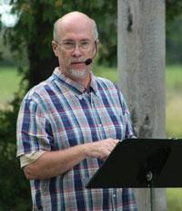 Pastor Bill Blue preaching.