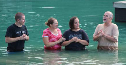 Pastor Bill Blue (right) and Chris Soltis, pastor of children and youth ministries (left) with baptism candidates.