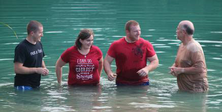 Pastor Bill Blue and Chris Soltis with baptism candidates.