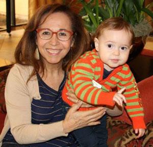 Reina Casco with a grandchild.