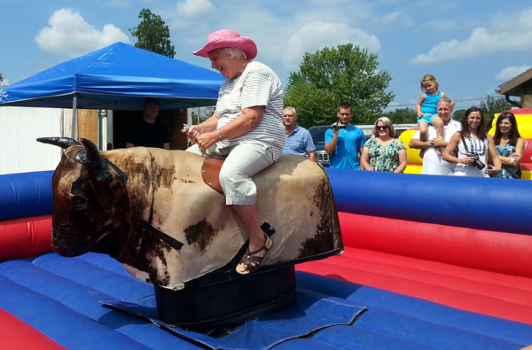 Riding the bull during the Back to School Bash.