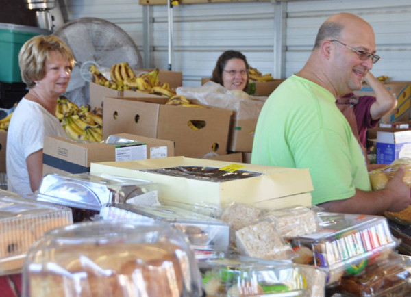 In the sorting shed. L-r: Gloria Woods, Marty Helman, and Dean Bentz.