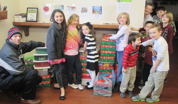 Children from Atlantic Avenue UB with shoeboxes for Samaritan's Purse.