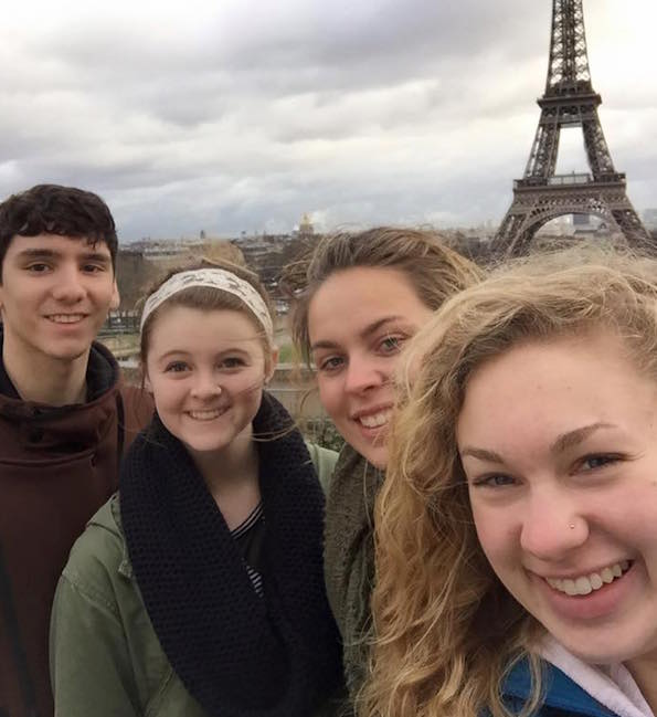 HU students with the Eiffel Tower in the background.
