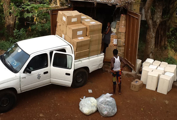 Unloading supplies sent for Ebola relief.