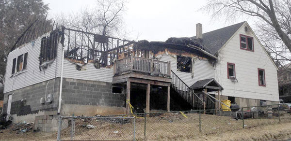 The fire-ravaged parsonage at Brooklyn Park.