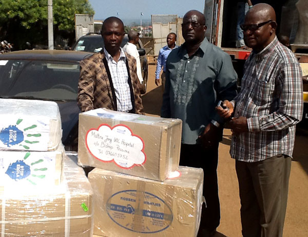 Bishop John Pessima (right) and others with supplies sent to Mattru Hospital by UBs in Berlin.