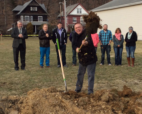 Gary Small, pastor of Atlantic Avenue, throwing a shovel of dirt.