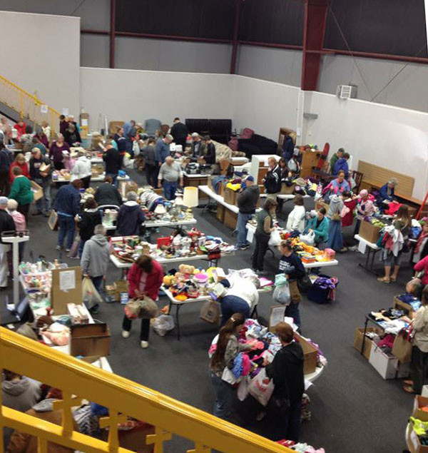 Shoppers perusing the various items for sale inside the Activity Center.