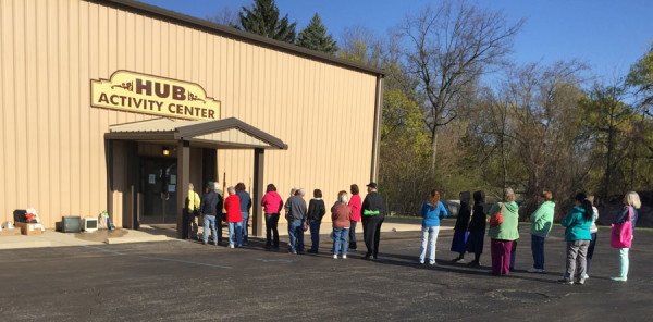 A line formed between the Activity Center and the church building, waiting for the sale to begin at 9 am on the opening day of the sale.