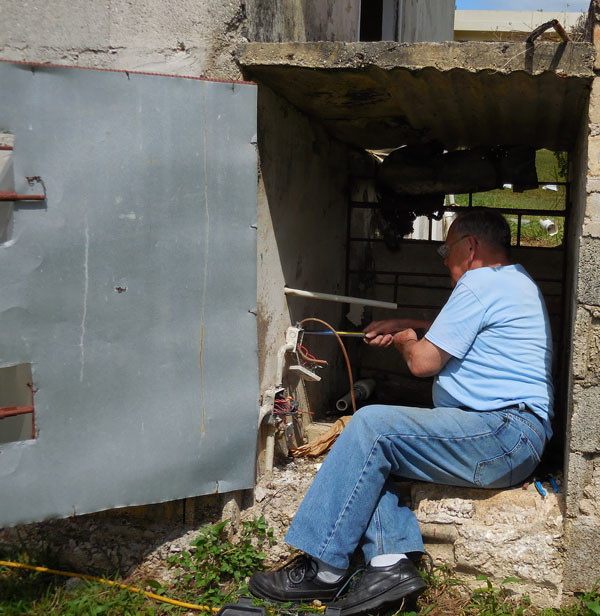 Working on the pump at Regent College of the Caribbean in Mandeville, Jamaica.