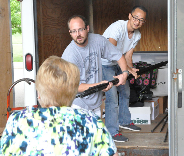 Frank Yang and David Kline unloading the trailer.