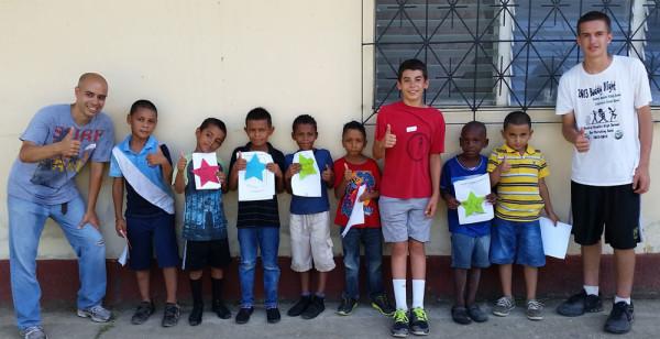 Derek Thrush (left) with children from Iglesia Luz in Puerto Cortes, Honduras.
