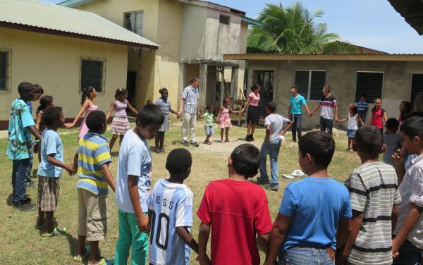 Praying with Honduran kids.