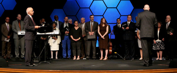 All of the ordination candidates, spouses, and assistants lined up across the platform.