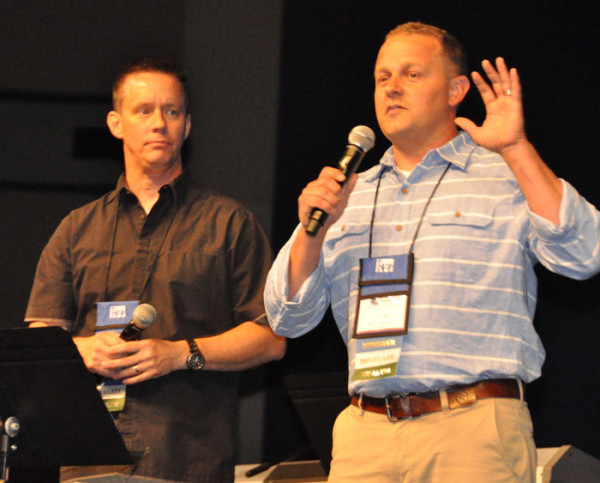 Emcees for the week are pastors from two nearby UB churches: Josh Good, right, pastor of Homefront UB in Grandville, Mich.; and Randy Carpenter, pastor of Sunfield UB in Sunfield, Mich.