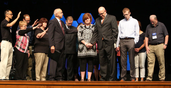 During the concluding service of National Conference on July 18, Bishop Paul Hirschy led a prayer of consecration for Todd and Lisa Fetters, family members, and the National Office staff.