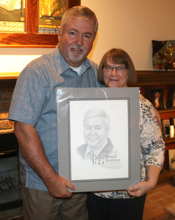 Phil and Sandy Whipple with the drawing by Barbara Bosworth.