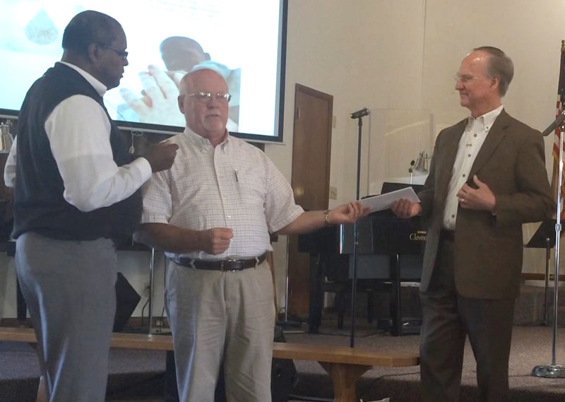 Presenting a check for $700 to Water4. L-r: Chet Conley (impact minister at First UB), Ron Monday (Mission's chair), and Jerry Rieger of Water4.