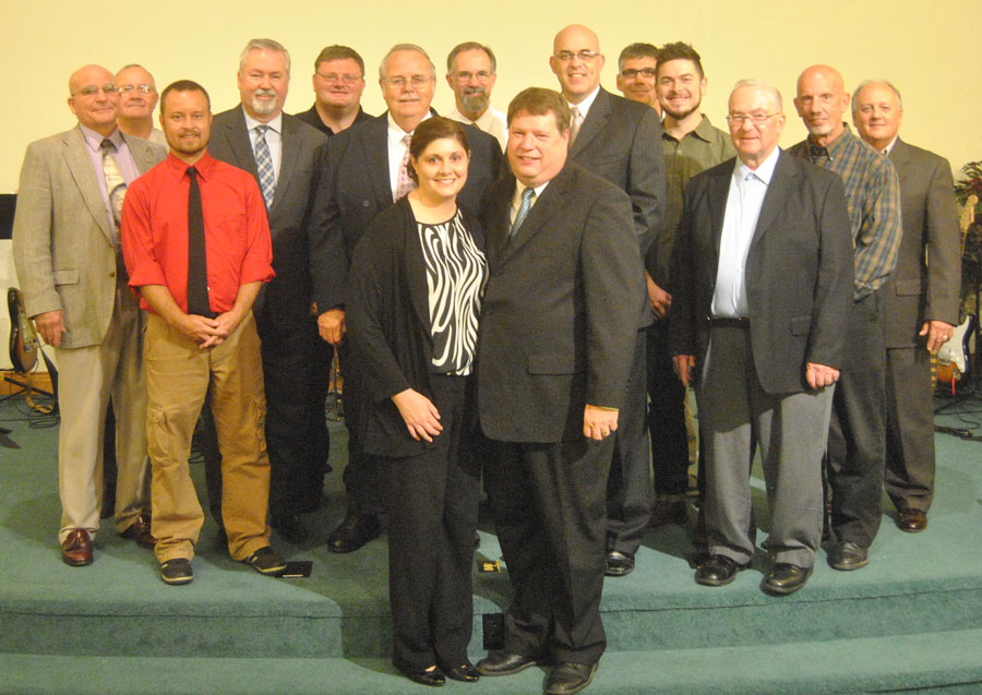 Scott and Amanda Graham (front) with participants in Scott's ordination.