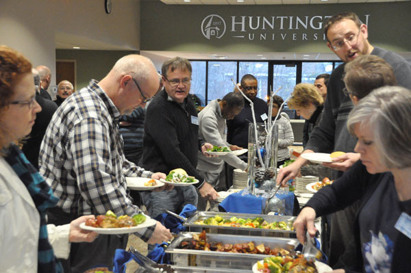 The cluster leaders, National Office staff, and spouses enjoyed a buffet dinner at Huntington University.