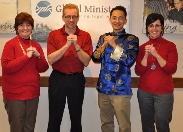 Donna with the Global Ministries staff giving a Chinese New Year's greeting for the Macau staff.