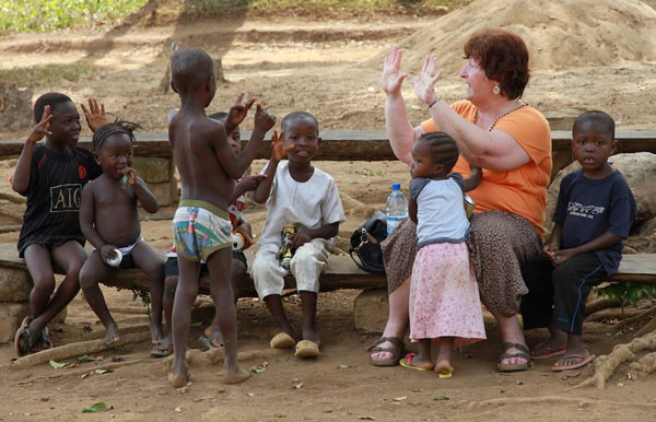 Donna Hollopeter having fun with children in Sierra Leone.