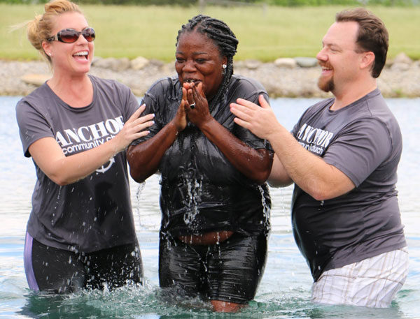 Kevin Whitacre (right) and Tomi Cardin (left) conduct one of the eight baptisms.