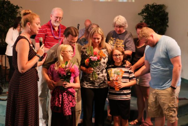 The Anchor Resource Team prays over the Whitacre family.