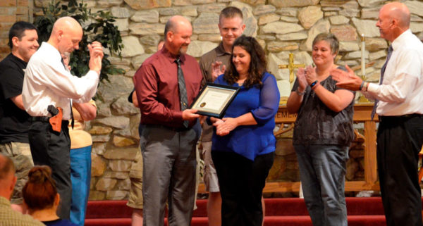 Andy Bashore, with wife Stacey, receiving a local conference license from Lancaster UB church. Senior pastor Greg Voight is on the far right.