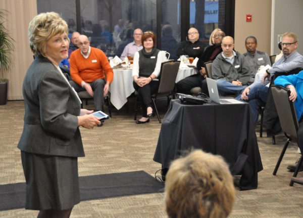 Dr. Sherilyn Emberton, president of Huntington University, welcomes the cluster leaders on Monday night.