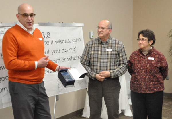 Todd Fetters presenting a gift of appreciation to Charlie and Paula Milliken.