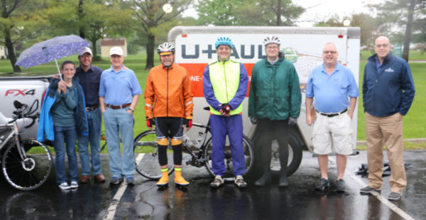 Amos and Annalee Rawley (left), Anthony Blair and Bishop Todd Fetters (right), and the bike team in between.