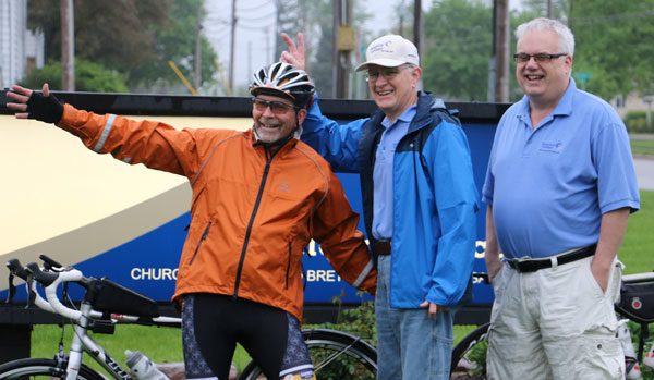 Dr. Anthony Blair (right) with members of the biking team.