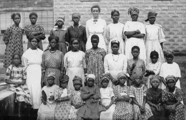 Minnie Mull with girls at the home at the Danvlile station in Sierra Leone.
