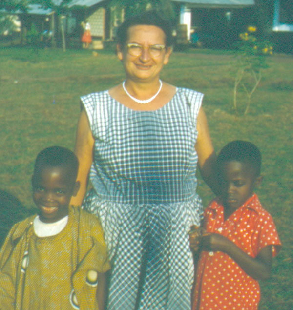 Martha Anna Bard with two African children.