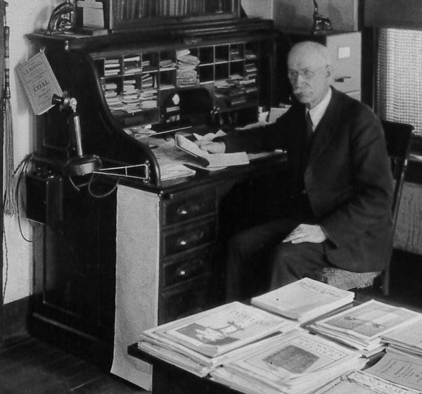 Jacob Howe at his desk in the missions office in Huntington, Ind.